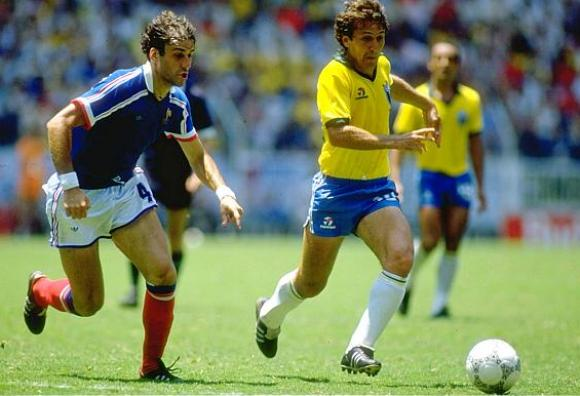 21 Jun 1986: Zico (right) of Brazil takes on Batiston of France during the World Cup quarter-final at the Jalisco Stadium in Guadalajara, Mexico. France won 4-3 on penalties. Mandatory Credit: David Cannon/Allsport